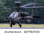 Small photo of FAIRFORD, UNITED KINGDOM - JULY 16, 2017: AgustaWestland WAH-64D Apache AH1 ZJ203 of Army Air Corps performing demonstration flight at Royal International Air Tattoo show at Fairford AFB