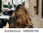 woman with flying hair from...   Shutterstock . vector #688000768