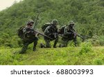 Small photo of Military, training, 30-7-2012 ,Rangers to find news, kneeling and looking at the enemy, the battle in the mountain forests.Tactical military training ground - Camp Si Song Rak, Loei, Thailand.