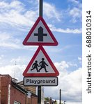 Small photo of Crossroad notice and Playground notice