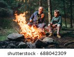 father and son roast... | Shutterstock . vector #688042309