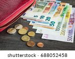 red wallet with euro money on... | Shutterstock . vector #688052458
