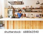 little girl cooking with her... | Shutterstock . vector #688063540