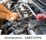 hand of car mechanic working in ... | Shutterstock . vector #688076596