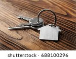 house key on  house shaped... | Shutterstock . vector #688100296