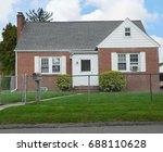 suburban brick bungalow home...   Shutterstock . vector #688110628