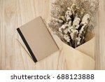 notebook with beautiful flower... | Shutterstock . vector #688123888