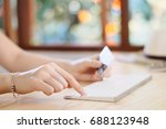 hand of woman holding credit... | Shutterstock . vector #688123948