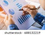 businessman analyzing financial ... | Shutterstock . vector #688132219