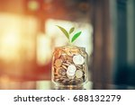 plant growing out of coins with ... | Shutterstock . vector #688132279