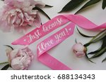 """Small photo of Photo of peonies and a satin pink ribbon with an inscription """"Just because I love you!"""" for postcard, poster"""