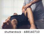therapist treating injured knee ...   Shutterstock . vector #688160710
