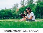 beautiful woman writing into... | Shutterstock . vector #688170964