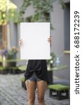 girl holds canvas background... | Shutterstock . vector #688172239