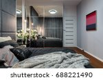 Stock photo new design bedroom with bed mirrored wardrobe and modern painting 688221490