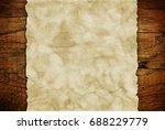 grunge paper sheet on wooden... | Shutterstock . vector #688229779