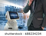 Small photo of Businessman suit passenger use self-driving robot assistant check in for ticket and accompany them to their gate at international airport.