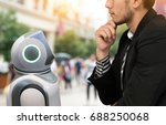 Small photo of Robotics Trends technology and robo advisor concept. Autonomous personal assistant robot and man suit decide to order it.