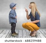 a young mother scolds her...   Shutterstock . vector #688259488