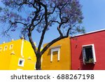 Yellow And Red House In...