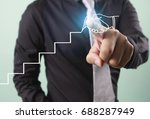 businessman touching graphic of ... | Shutterstock . vector #688287949