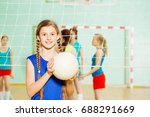 Teen Girl With Volleyball Ball...