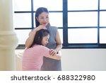 mother comforting her sad...   Shutterstock . vector #688322980