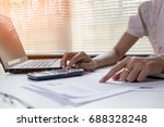 businesswoman calculate about... | Shutterstock . vector #688328248