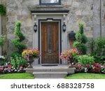 front door with flowers | Shutterstock . vector #688328758