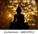 buddha shadow buddha on the... | Shutterstock . vector #688329013