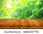 empty wooden table for product... | Shutterstock . vector #688335790