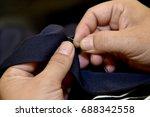 closeup hands of tailor man... | Shutterstock . vector #688342558