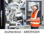 engineer using laptop computer... | Shutterstock . vector #688354264