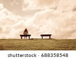 a women sitting alone on a... | Shutterstock . vector #688358548