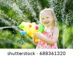 adorable little girl playing... | Shutterstock . vector #688361320