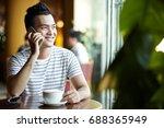 smiling vietnamese man calling... | Shutterstock . vector #688365949