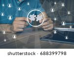Stock photo man holding pieces of jigsaw puzzle business matching concept crowd sourcing freelancer 688399798