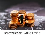 Small photo of Miniature: Demon of death standing on coins stack coins using as background business concept