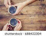 coffee in hand. the lovers are... | Shutterstock . vector #688422304