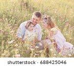 happy family in flowers meadow | Shutterstock . vector #688425046