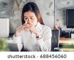 frustrated asian businesswoman... | Shutterstock . vector #688456060