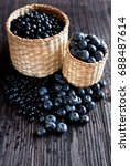 Small photo of berries in a bast basket