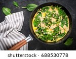 omelet with eggs  spinach  pine ... | Shutterstock . vector #688530778