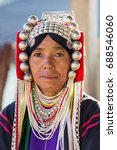 Small photo of Chiang Rai, Thailand - February 8, 2017: Portrait of an unidentified Akha woman with traditional clothes and silver jewelery in Akha hilltribe village in Northern Thailand