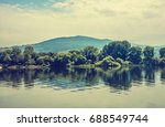 calm scene with boats mooring... | Shutterstock . vector #688549744