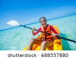 beautiful girl with kayak... | Shutterstock . vector #688557880