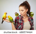 woman feeding parrots. isolated ...   Shutterstock . vector #688574464