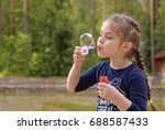 Adorable Little Girl Blowing...