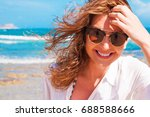 happy woman on the beach | Shutterstock . vector #688588666