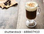 Irish Coffee In Glass On Woode...